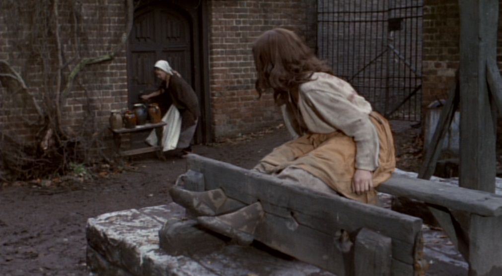 Naked woman in the pillory