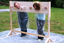 throwing-sponges-at-people-in-stocks-as-team-building-exercise-BN7BWM.JPG.